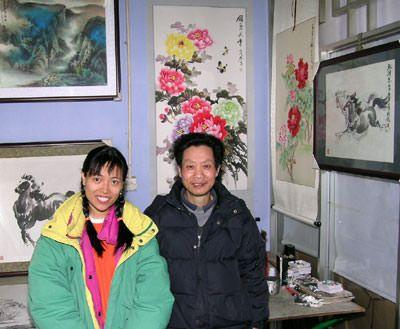 Chinese artist Cheng Zheng-Long and Cat at his studio in Chengdu, China